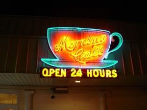 coffee cup and saucer neon light iwth open 24 hours