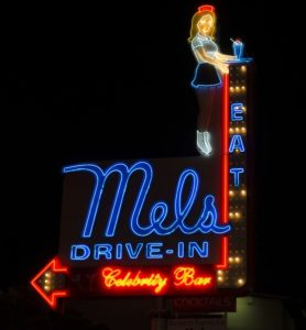 Mel's Drive-In with young woman in roller skates holding a shake